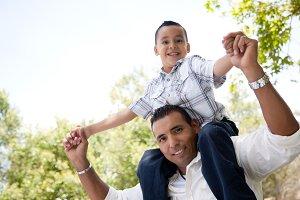 Hispanic Father and Son Having Fun T
