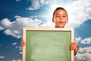 Boy Holding Blank Chalk Board, Sky