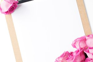 Pink Roses & Clipboard Stock Photo