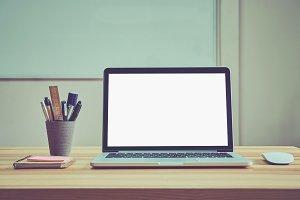 Laptop blank screen on the desk.