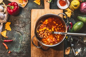 Bean soup in cooking pot with ladle
