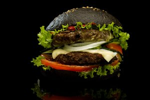 Black burger on a black background