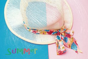 beach hat on colorful background