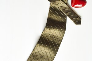 Necktie on white wooden background