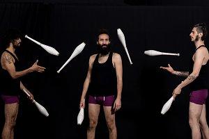 Circus jugglers during their batons