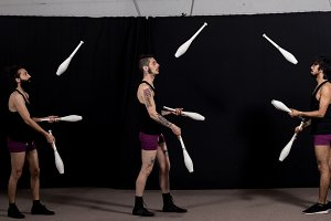 Circus jugglers during their batons