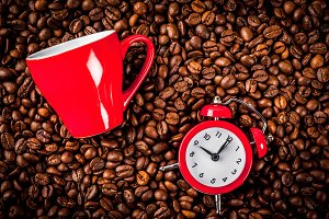 Coffee cup with alarm clock