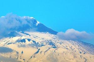 Smoking Etna volcano in Sicily