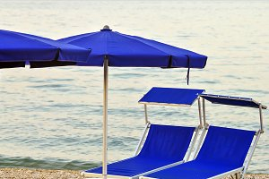 Umbrellas, sunbeds at beach