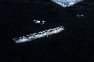 Ice in deep dark water