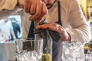 Bartender makes cocktail