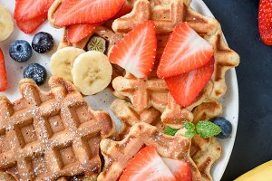 Homemade waffles served with berries