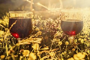 Two glasses red wine in sunny rays