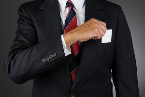 Businessman Taking Blank Card Pocket