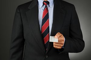 Businesman Holding Credit Card