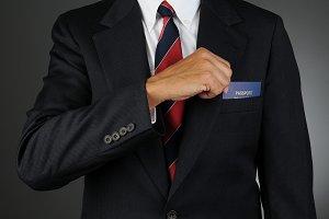 Businessman Taking Passport Pocket