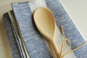 Wooden spoon on linen towel