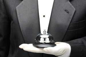 Man in TuxedoHolding Service Bell