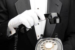 Valet Holding Dial Telephone
