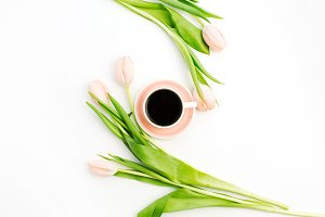 Coffee cup and pink tulips