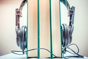 Headphones and old book