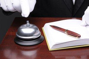 Desk Clerk Ringing Service Bell