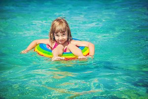 Child in the water. Selective focus.