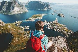 Backpacker Man sitting on cliff edge