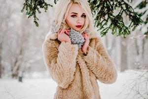 A charming girl standing by the tree