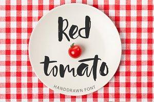 Red tomato. Script font.