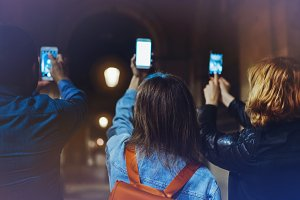 A group of people using smartphones