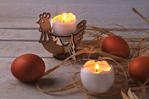 Rustic composition. candles and eggs