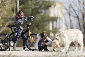 Two children enjoying a picnic