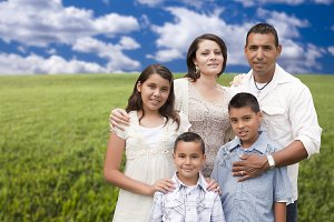 Family Portrait Standing in Grass