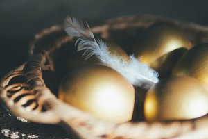 Golden Easter eggs in a wooden
