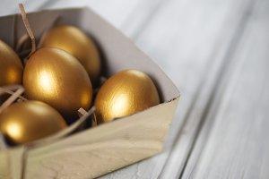 Golden Easter eggs in gift box