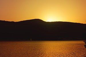 the sun behind the mountain
