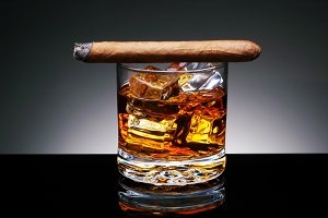 Cigar on Glass of Whiskey