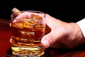 Hand with Whiskey Glass and Cigar