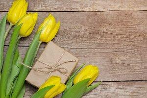 Yellow tulips and gift box.