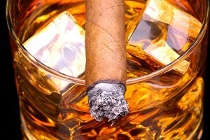 Cigar on Whiskey Vertical Closeup