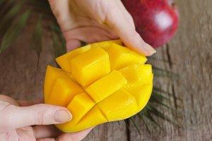 Fresh mango on wooden background