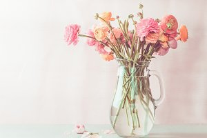Ranunculus bouquet in glass jug