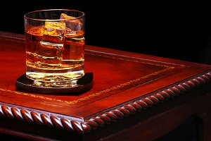 Whiskey Glass on Table