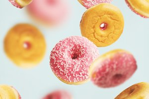 Flying pink glazed doughnuts