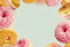 Falling or flying pink doughnuts