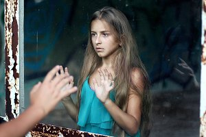 Teenage girl in a dilapidated house