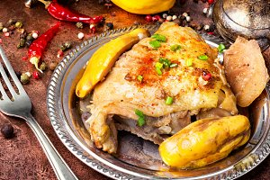 Baked chicken legs with quince sauce