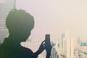 Man taking photos of city view