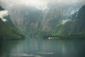 View over misty Lake Konigssee